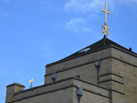The finished weathervane and cross looking respendent atop Bradford Cathedral.