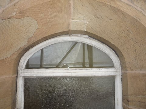 Both of the window openings were irregular and asymmetrical with no fixed radius or shape