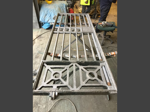 An original gate was used as reference for our patternmaker to enable us to manufacture new carved patternwork to enable us to cast replica sections to replace irrepairable or missing sections of the gates.