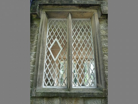 Two of the original cast iron windows had, in the past, been replaced with timber casement windows.