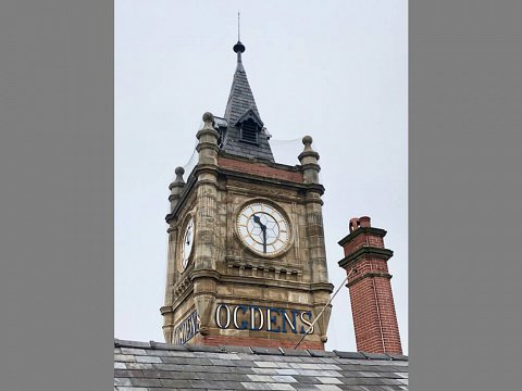 The restored clock faces were secured into their original repaired openings with new fixings.