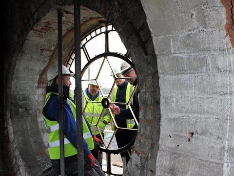 The restored clock faces were secured into their original repaired openings with new fixings before re-glazing.