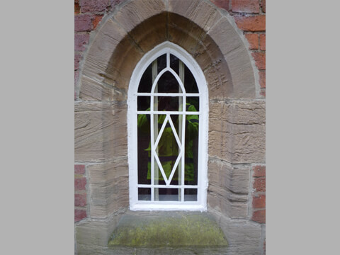 Two original cast iron arched windows had been removed and glazed with single panes decorated with self adhesive lead!