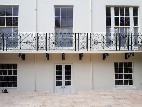 The balustrades along the balcony, were designed to be sleek and elegant, in keeping with a well known historic design.