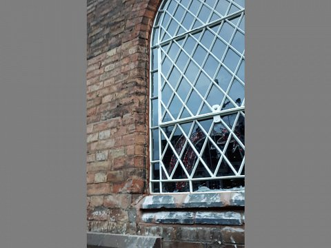 We reinstated the two restored windows and sealed them into the school's brickwork.