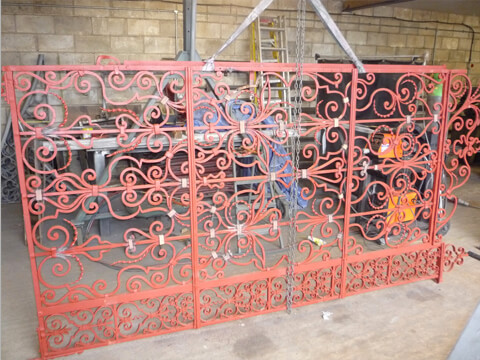 The right hand Mansion gate undergoing careful restoration. We had to replace a number of the collars and twisted iron tendrils with puddled wrought iron.